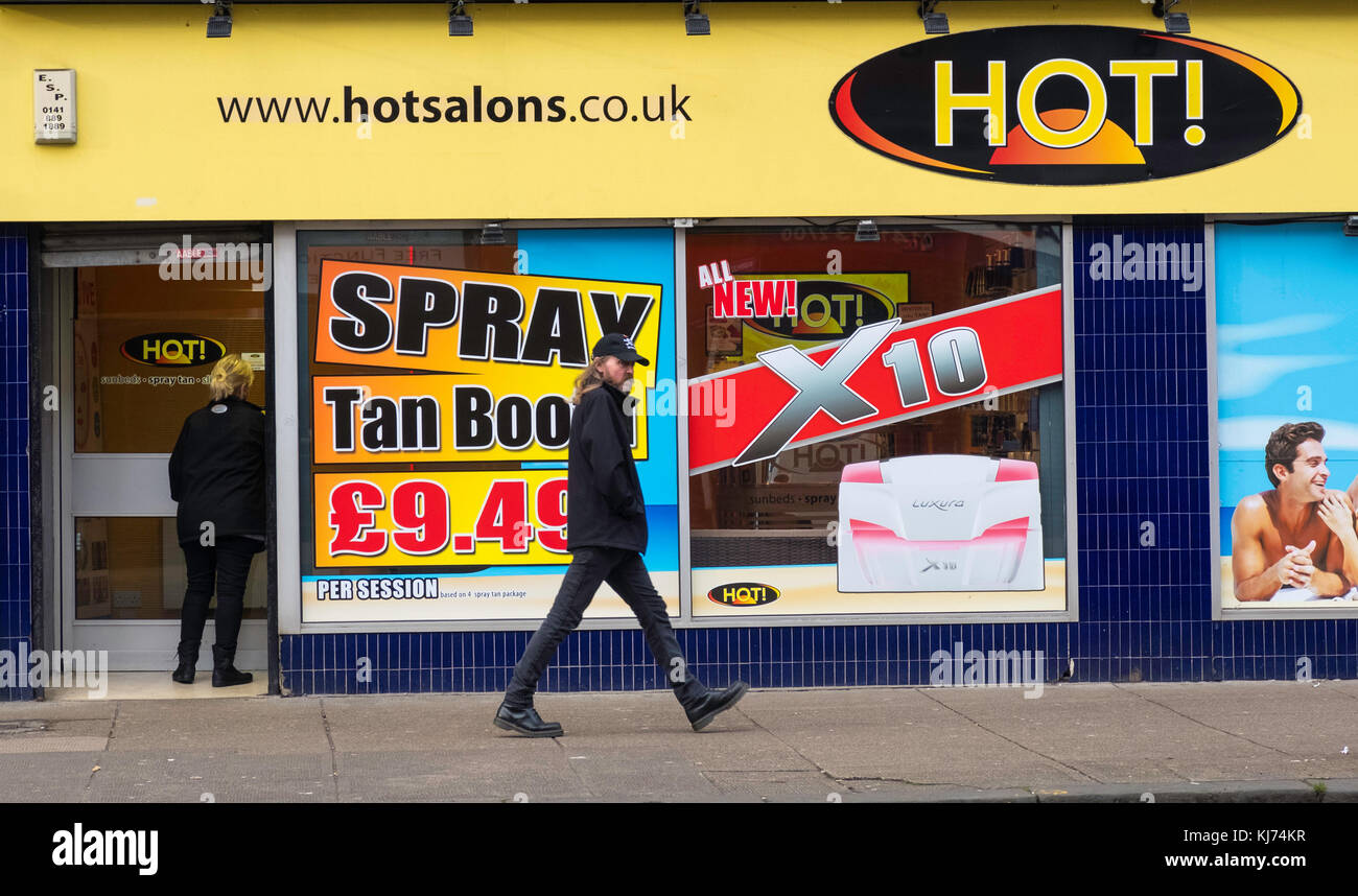Tanning salon on Victoria Road in Govanhill district of Glasgow, Scotland,United Kingdom - Stock Image