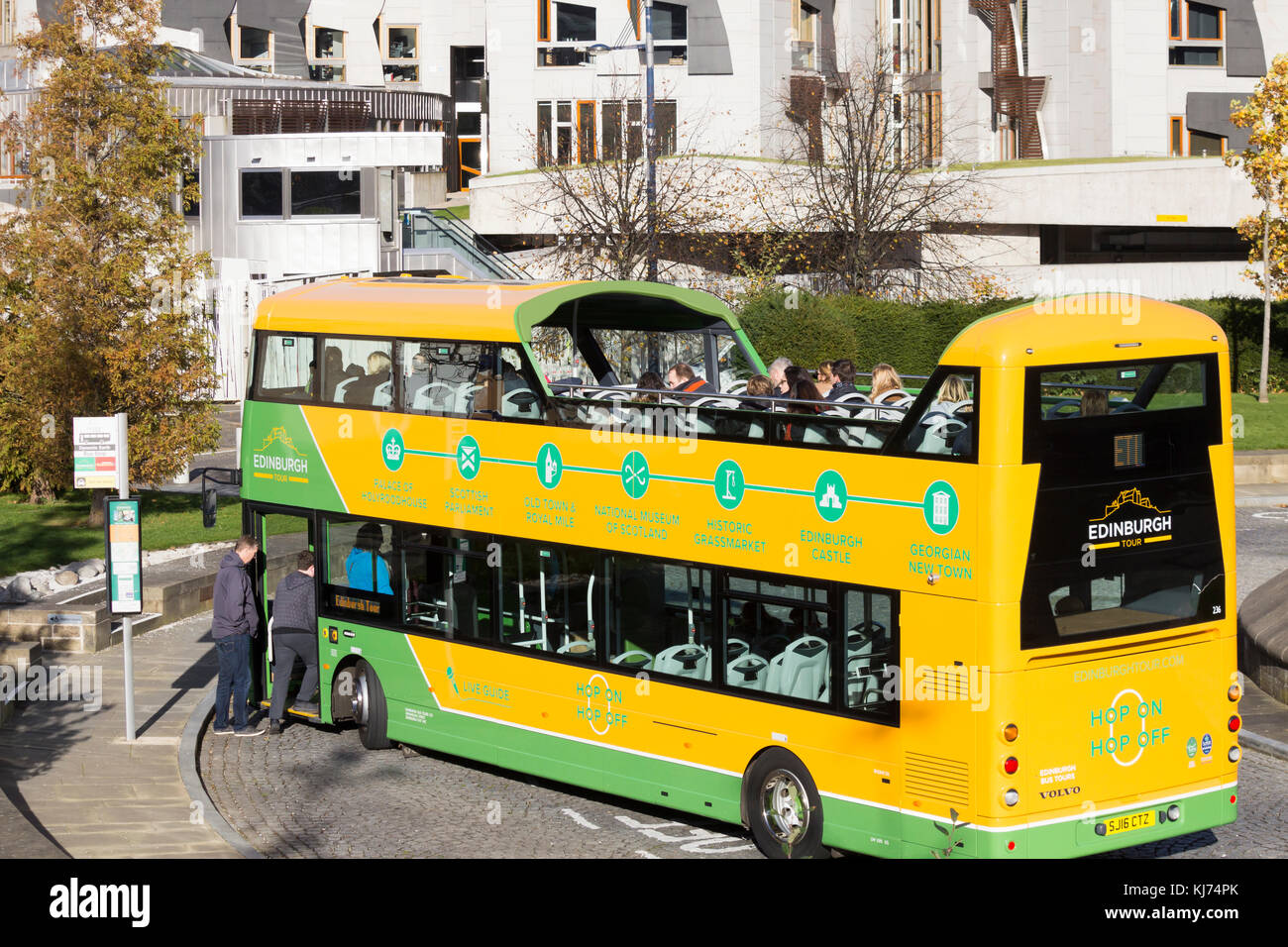 Sightseeing bus outside Scottish Parliament building in Edinburgh, Scotland. UK - Stock Image