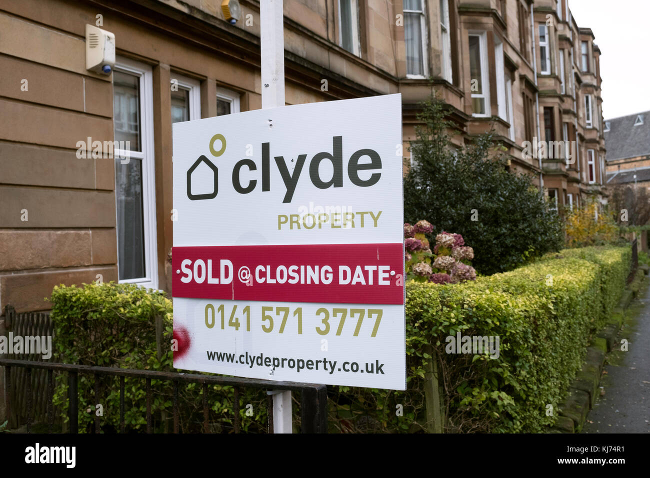 Sold sign outside tenement apartment building in Govanhill district of Glasgow, Scotland, United Kingdom - Stock Image