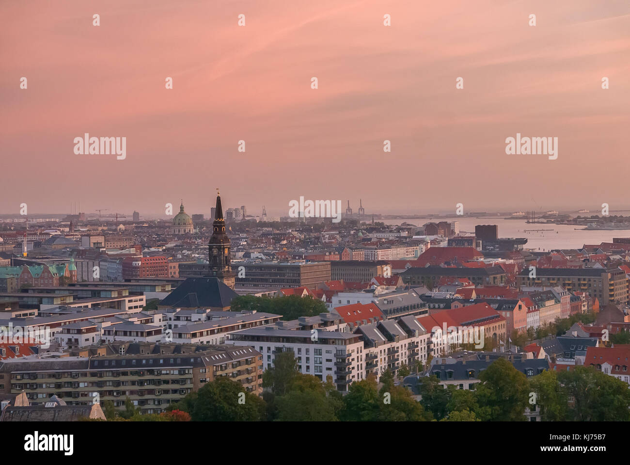 Copenhagen skyline with industrial harbor area at sunrise - Stock Image
