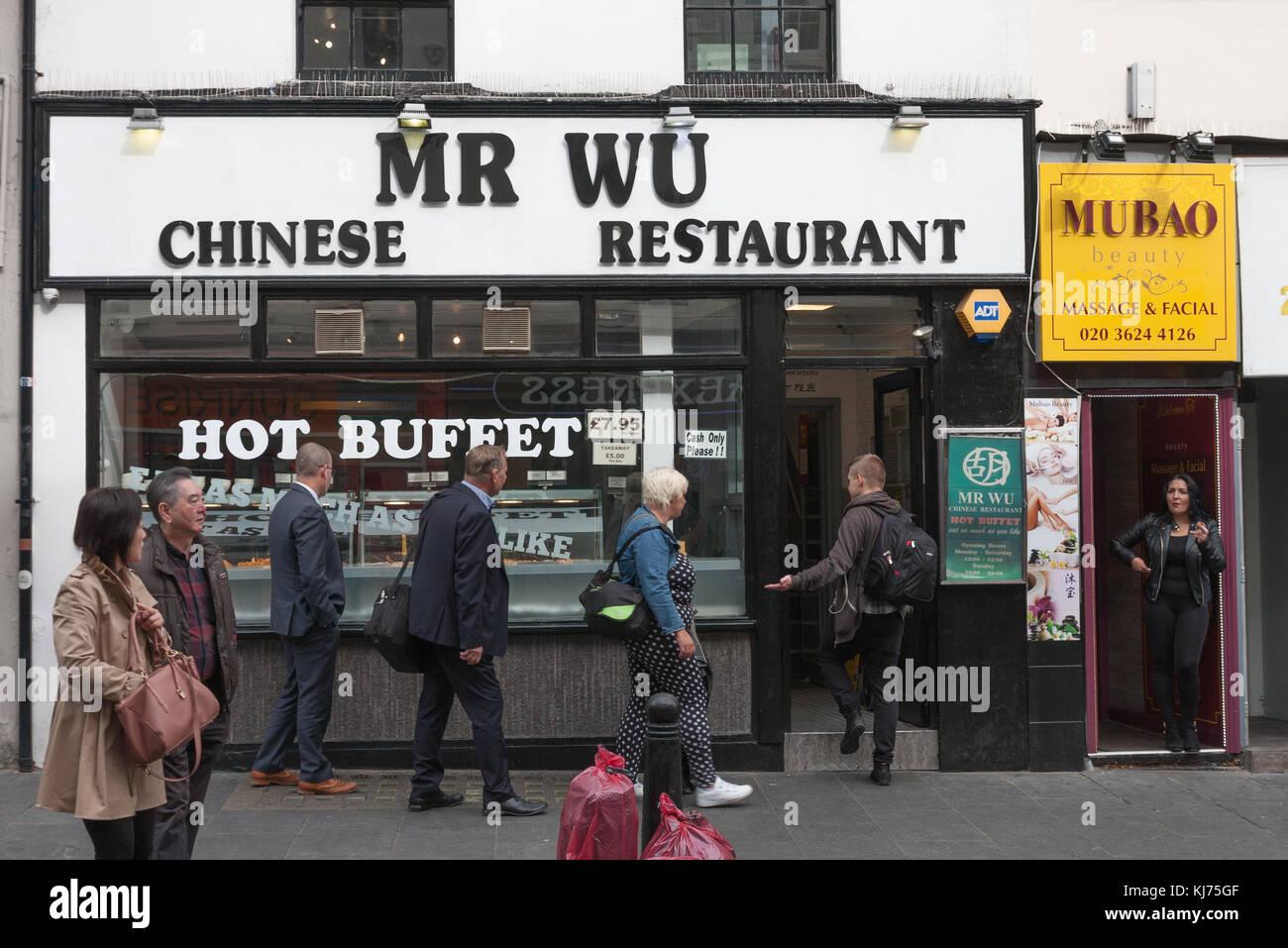 Wardour Street, London-September 6,2017: People visit Mr Wu Chinese Restaurant on Wardour Street on September 6, - Stock Image
