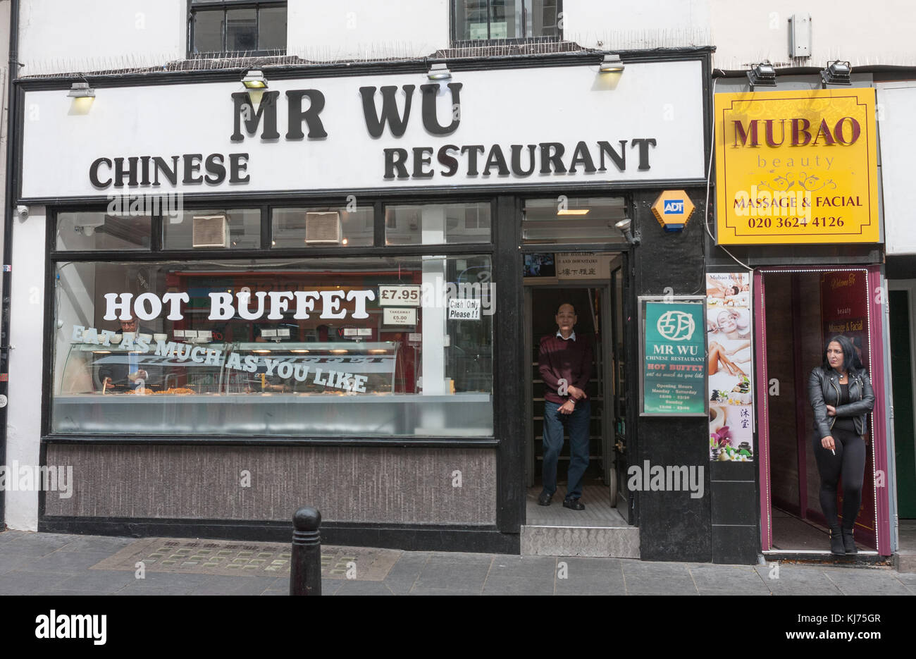 Wardour Street, London-September 6,2017: The head of  Mr Wu Chinese Restaurant standing in the door on Wardour Street Stock Photo