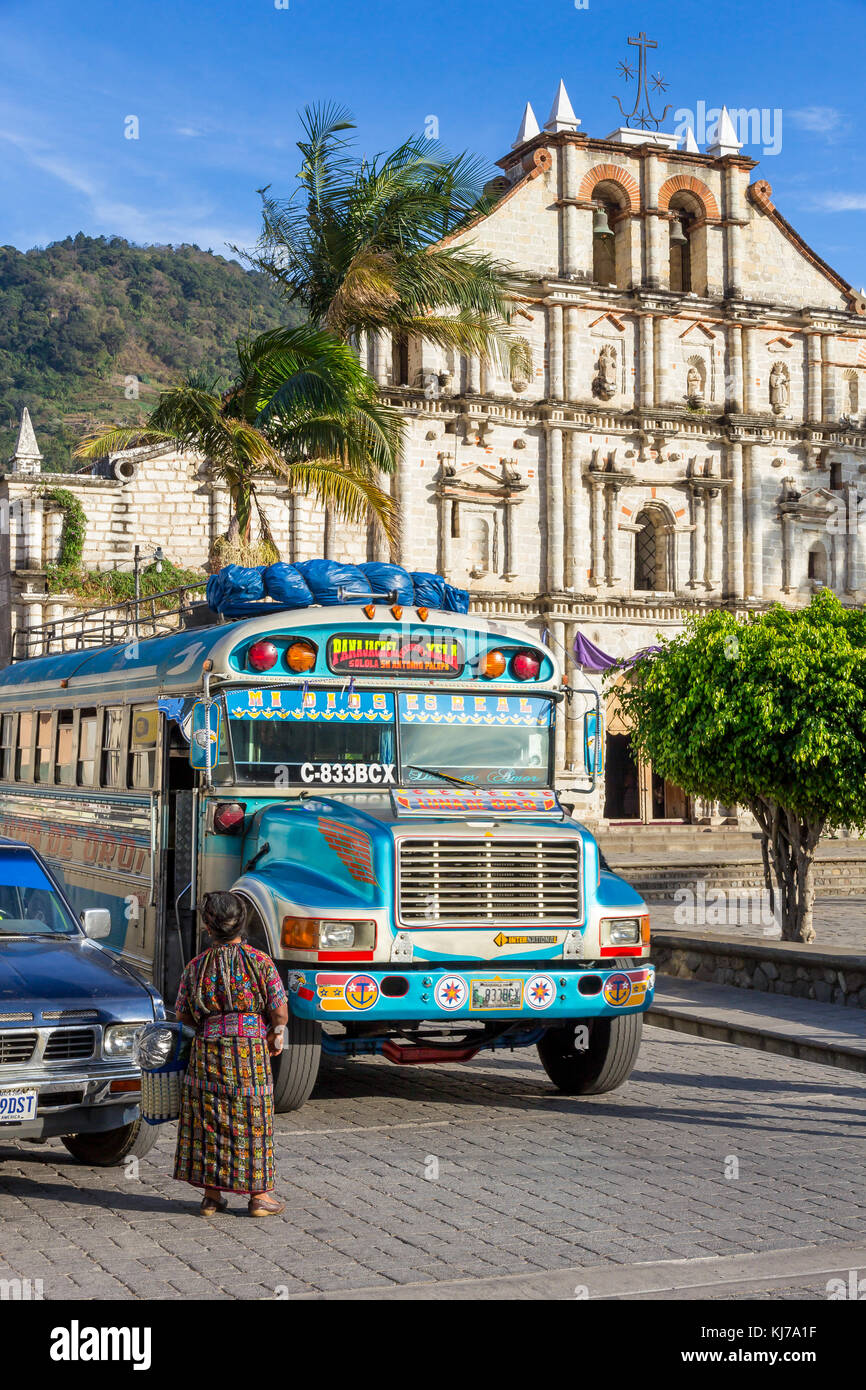 Chicken bus stopping at cathedral | Panajachel | Guatemala - Stock Image