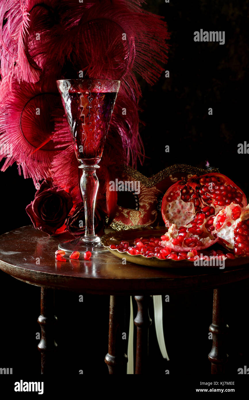 Pomegranate and wine, on a table - Stock Image