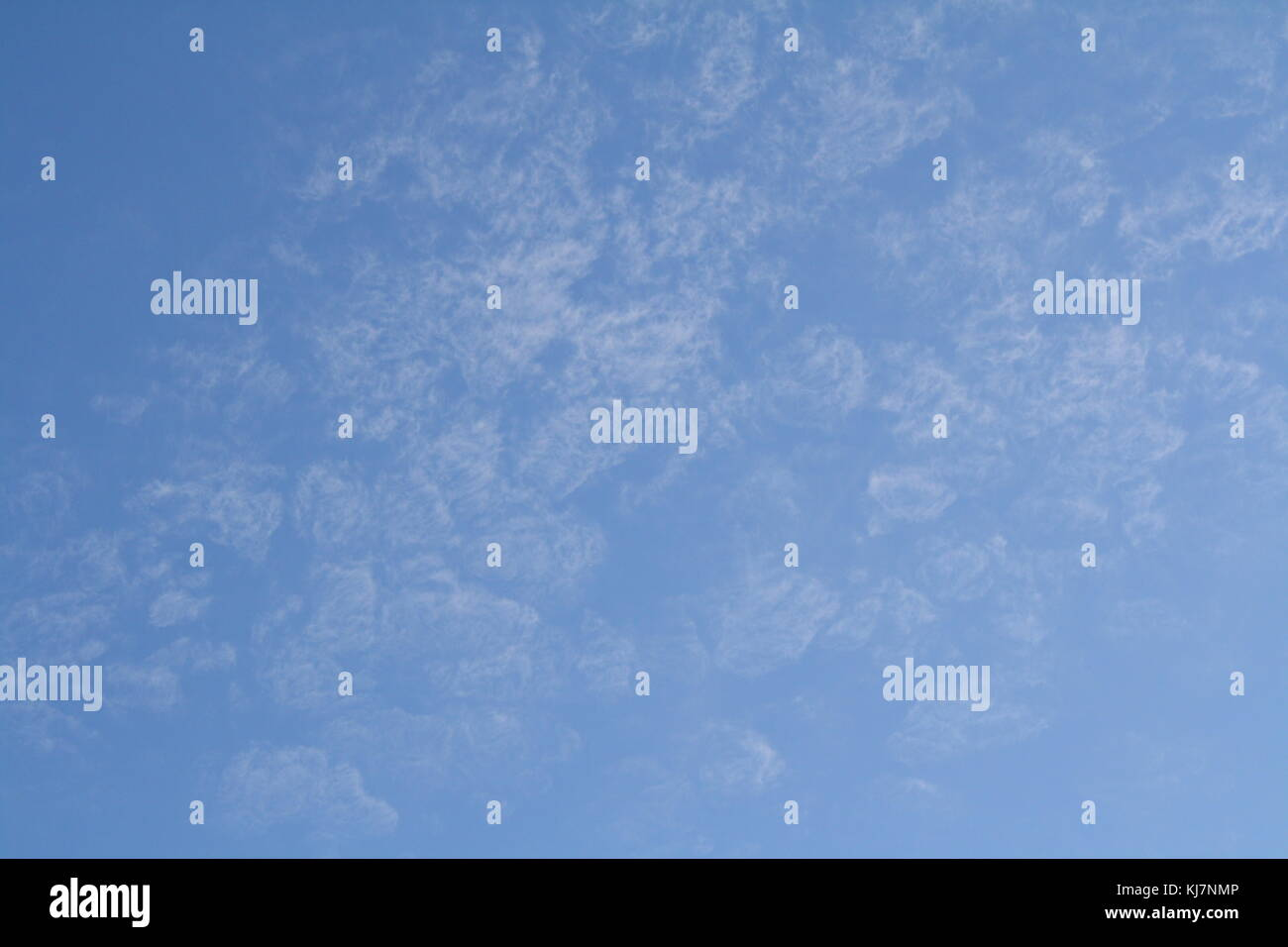Soft clouds in the blue sky, over Barcelona Spain. - Stock Image