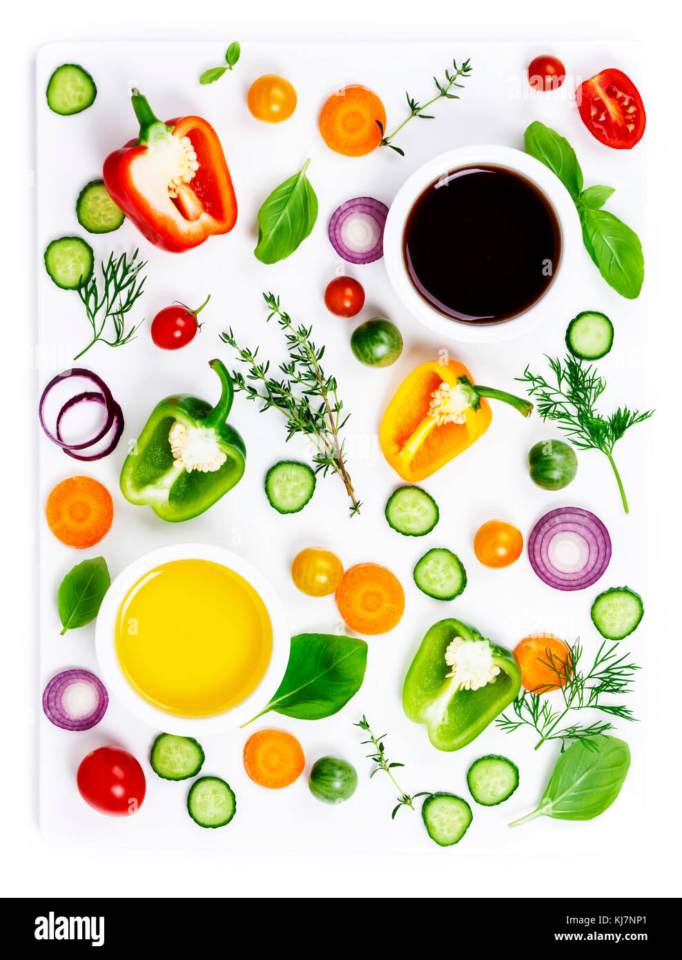 Composition of Fresh organic vegetables (pepper, onion, cucumber, carrot, tomatoe), herbs, olive oil and vinegar - Stock Image