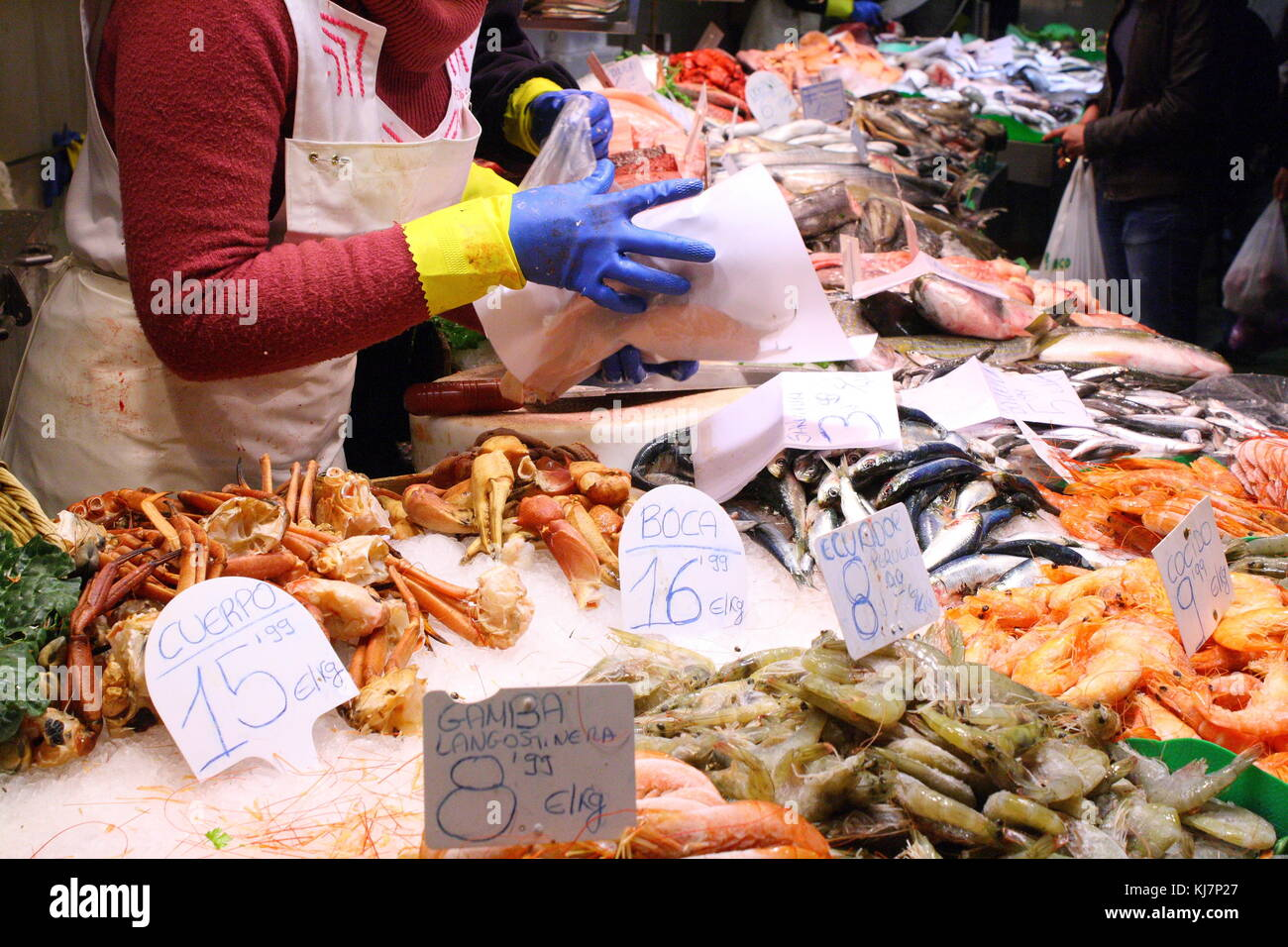 Crabs and shrimp to buy on display at the seaside fish market. - Stock Image