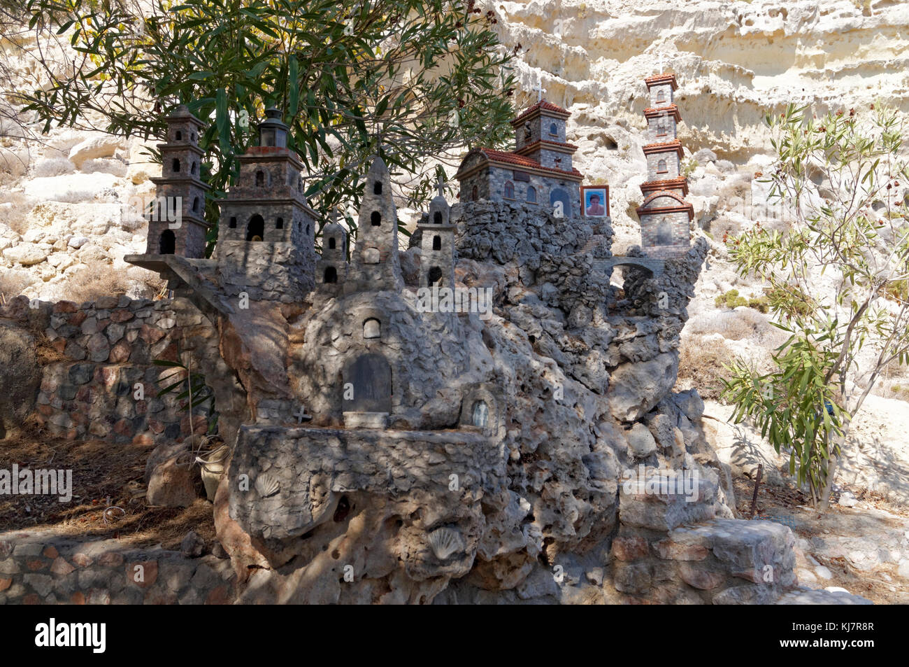 Memorial model of churches and religeous buildings in great detail, made from pebbles found on beach, near Archangelos, - Stock Image