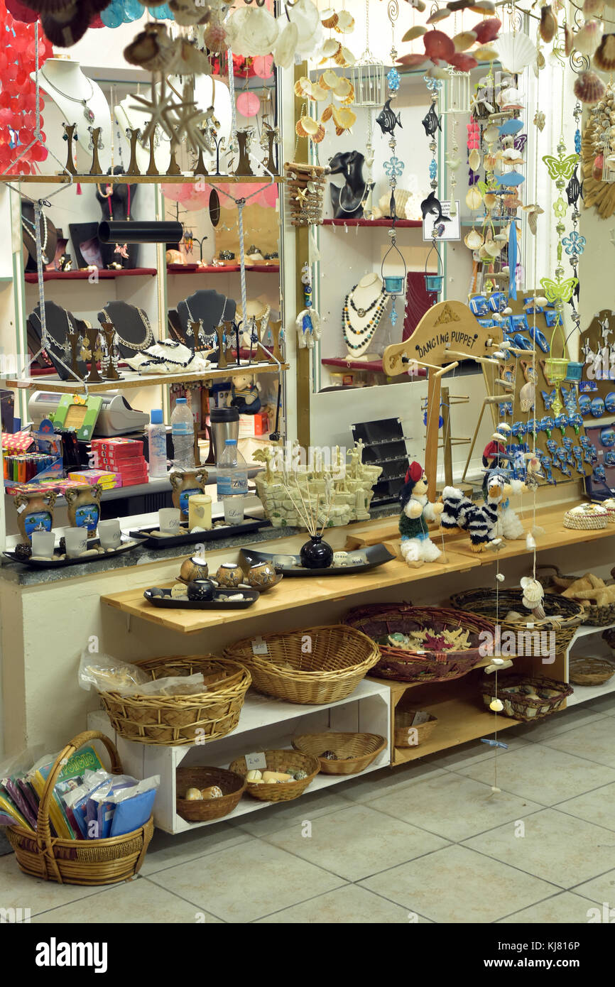 Various good and souvenirs for sale in a tourist shop in kassiopi on the island of Corfu in greece. Souvenirs and - Stock Image