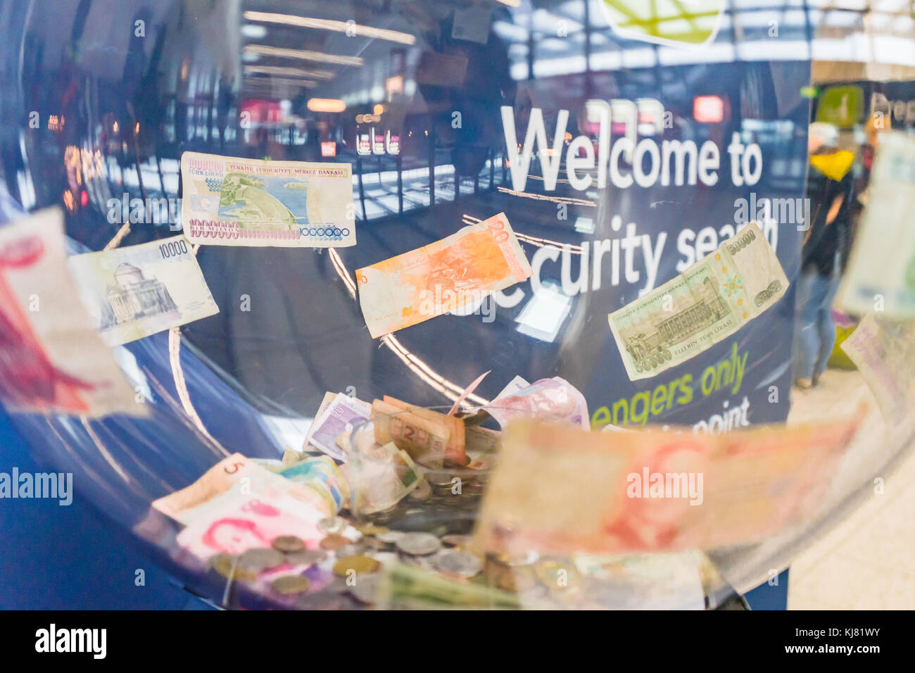 Foreign currency money donation box at Gatwick airport, England, UK - Stock Image