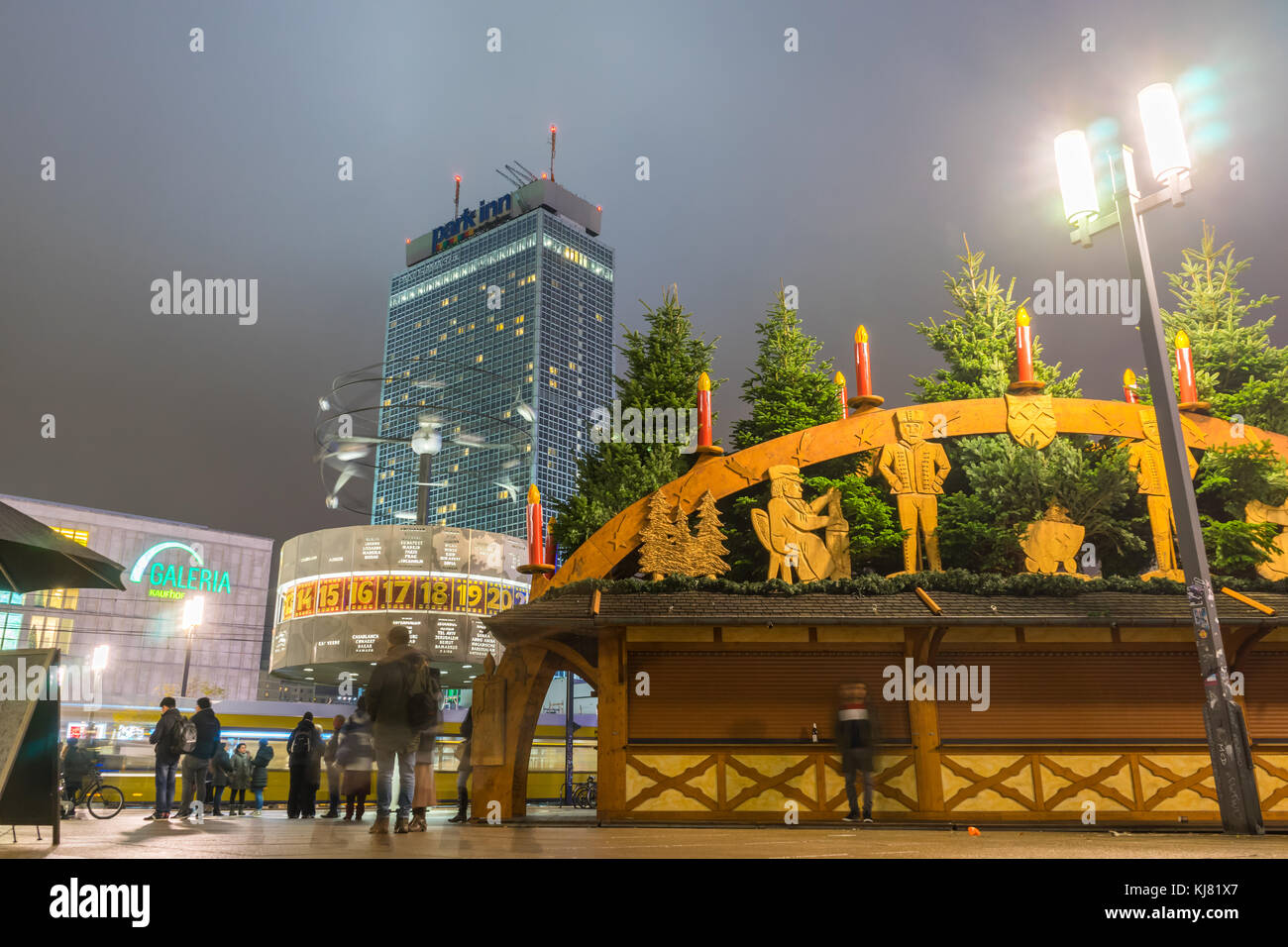 View over Alexanderplatz in Berlin at night with the World time clock (Weltzeituhr) and the Park Inn Hotel and the - Stock Image