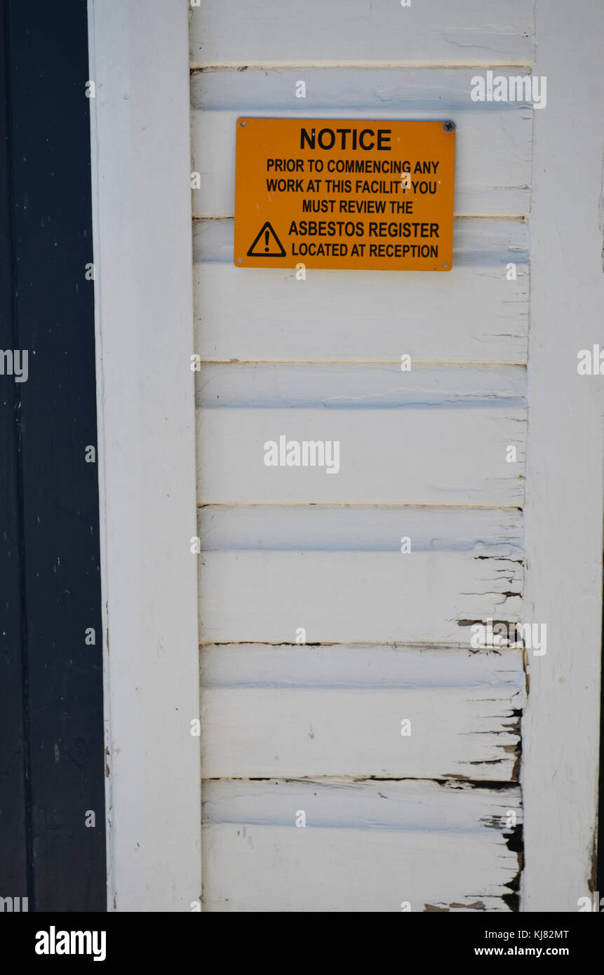 Warning sign indicating asbestos is present on site taken at The Entrance NSW Australia - Stock Image