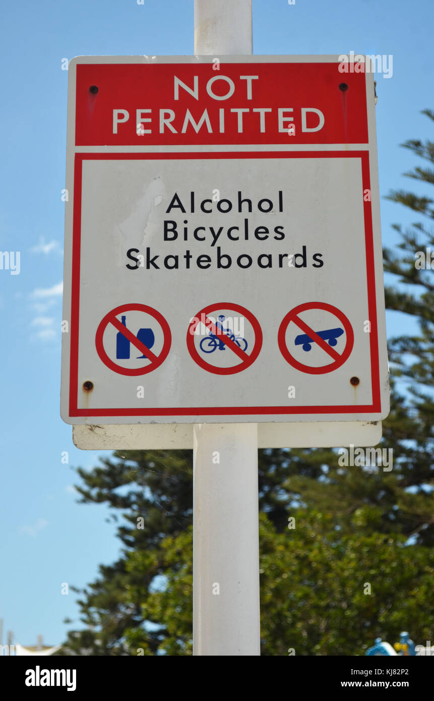 Sign indicating alcohol, bicycles and skateboards are not permitted at The Entrance, Central Coast, NSW Australia - Stock Image
