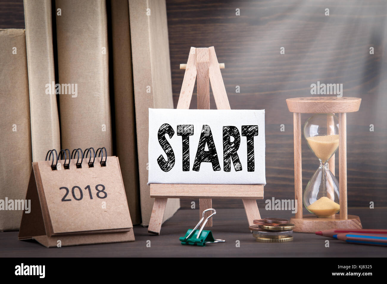2018 start. Sandglass, hourglass or egg timer on wooden table - Stock Image