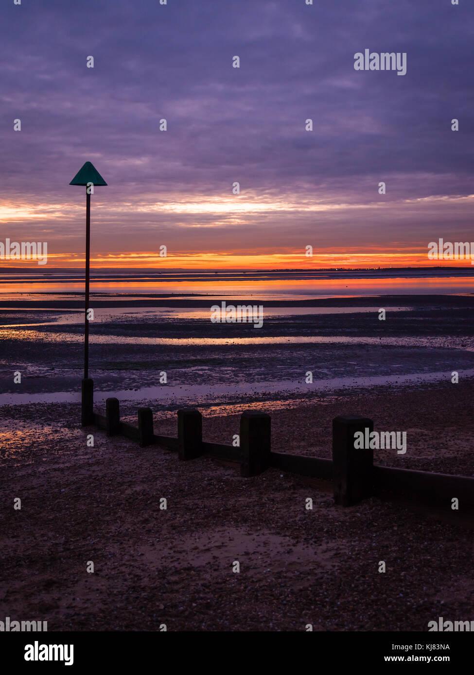 Sun setting on Chalkwell beach - Stock Image