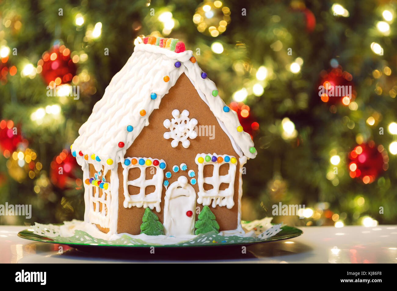 Christmas Gingerbread House Background.Homemade Christmas Gingerbread House Displayed On A Table