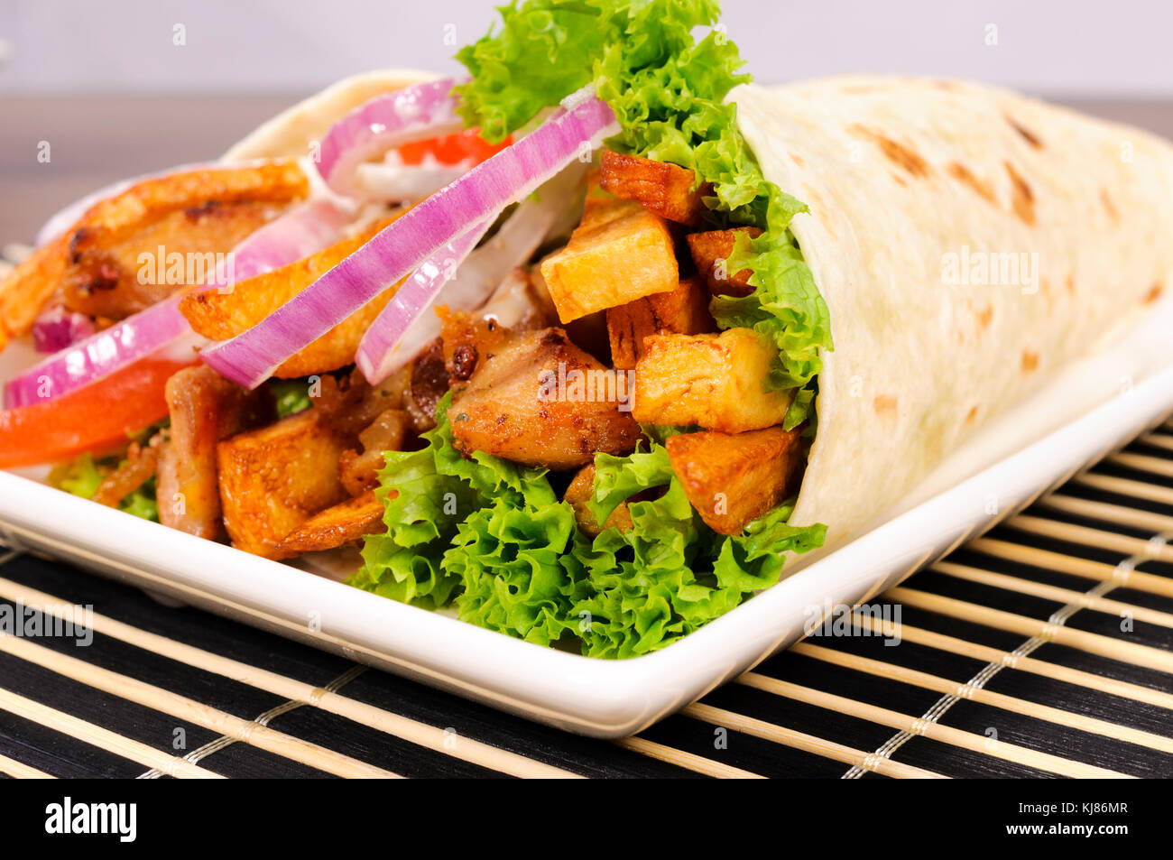 Selective focus in the middle of doner kebab - Stock Image