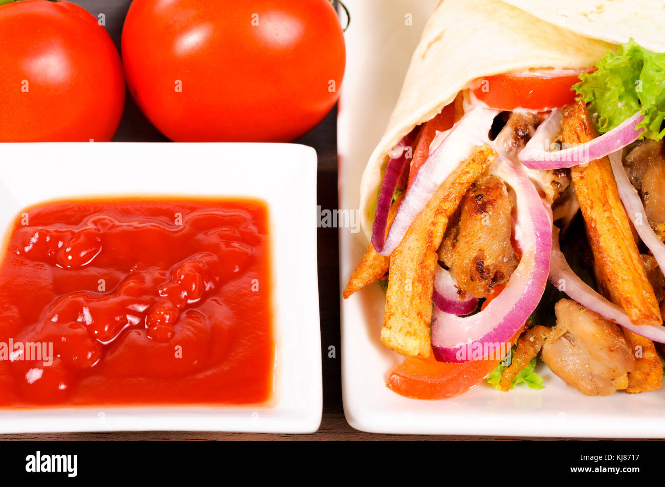 Selective focus on the gyros and ketchup - Stock Image