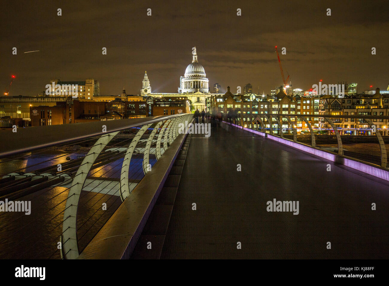 Sir Norman Foster's Wobbly Millennium Pedestrian Bridge from Southbank to Sir Christopher Wren's iconic - Stock Image