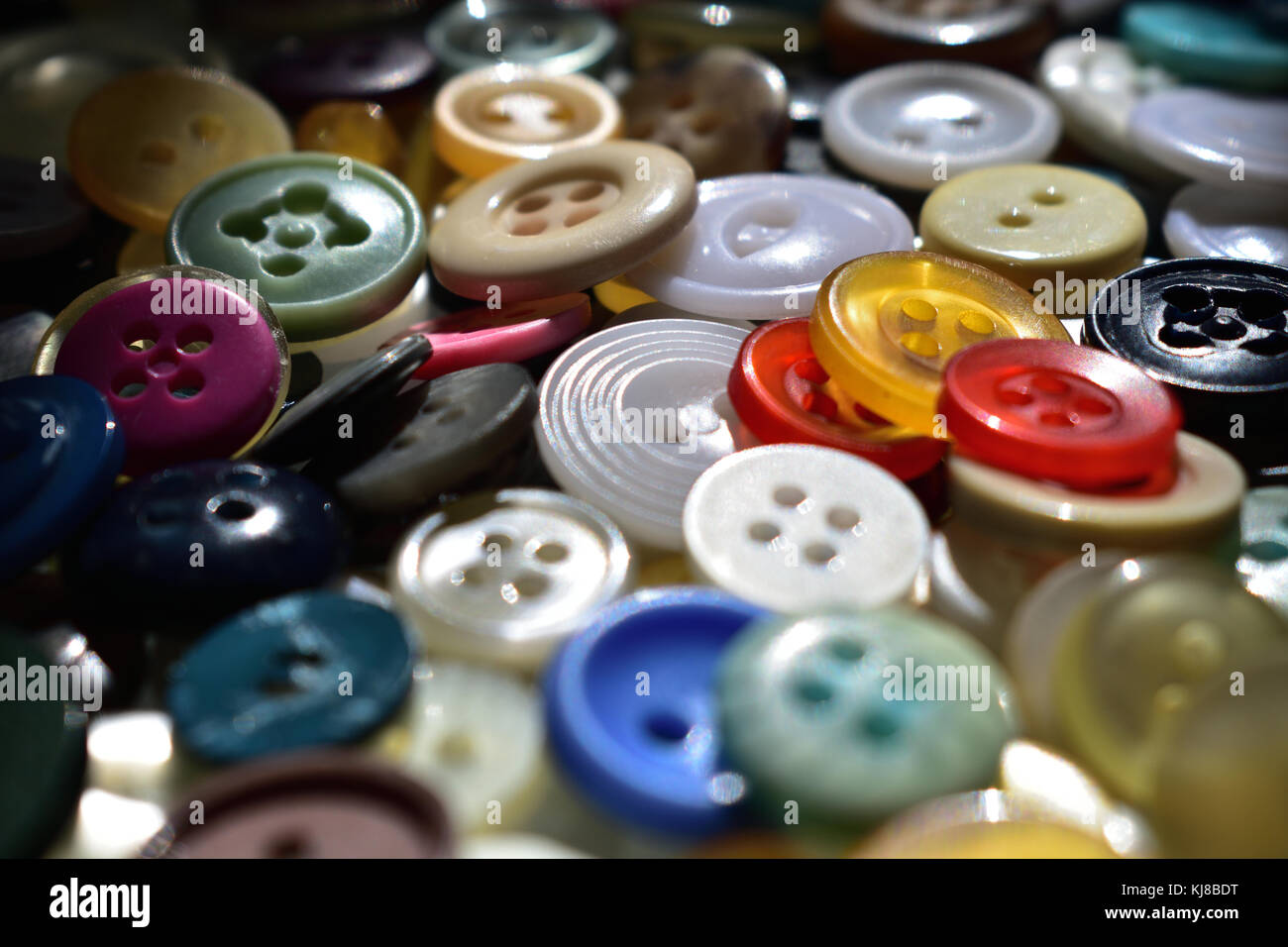 An assortment of colourful buttons - Stock Image
