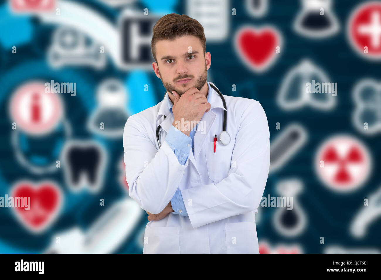 Portrait of confident young medical doctor on background with medical symbols. - Stock Image