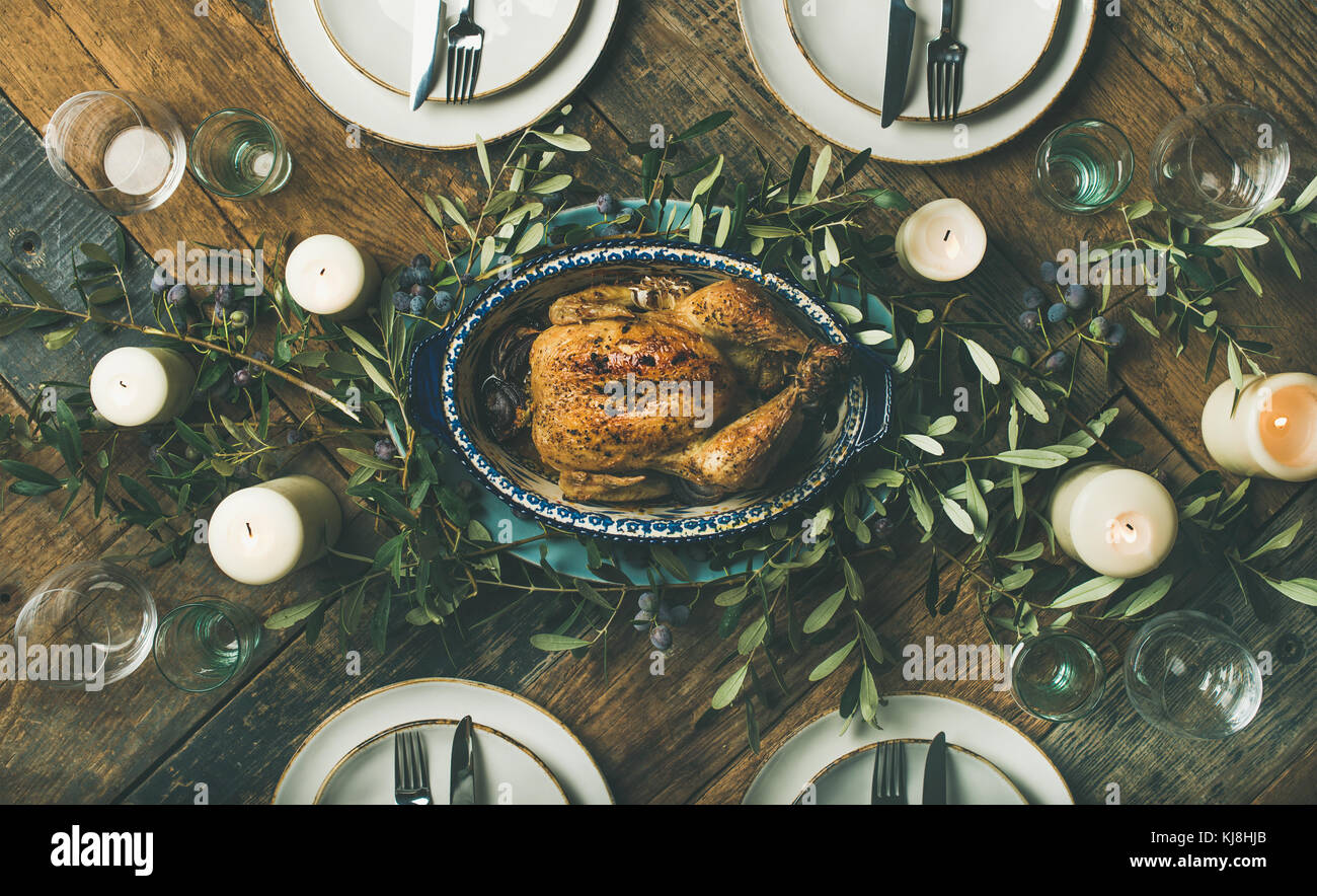 Holiday table setting for party, gathering or celebration roast chicken - Stock Image