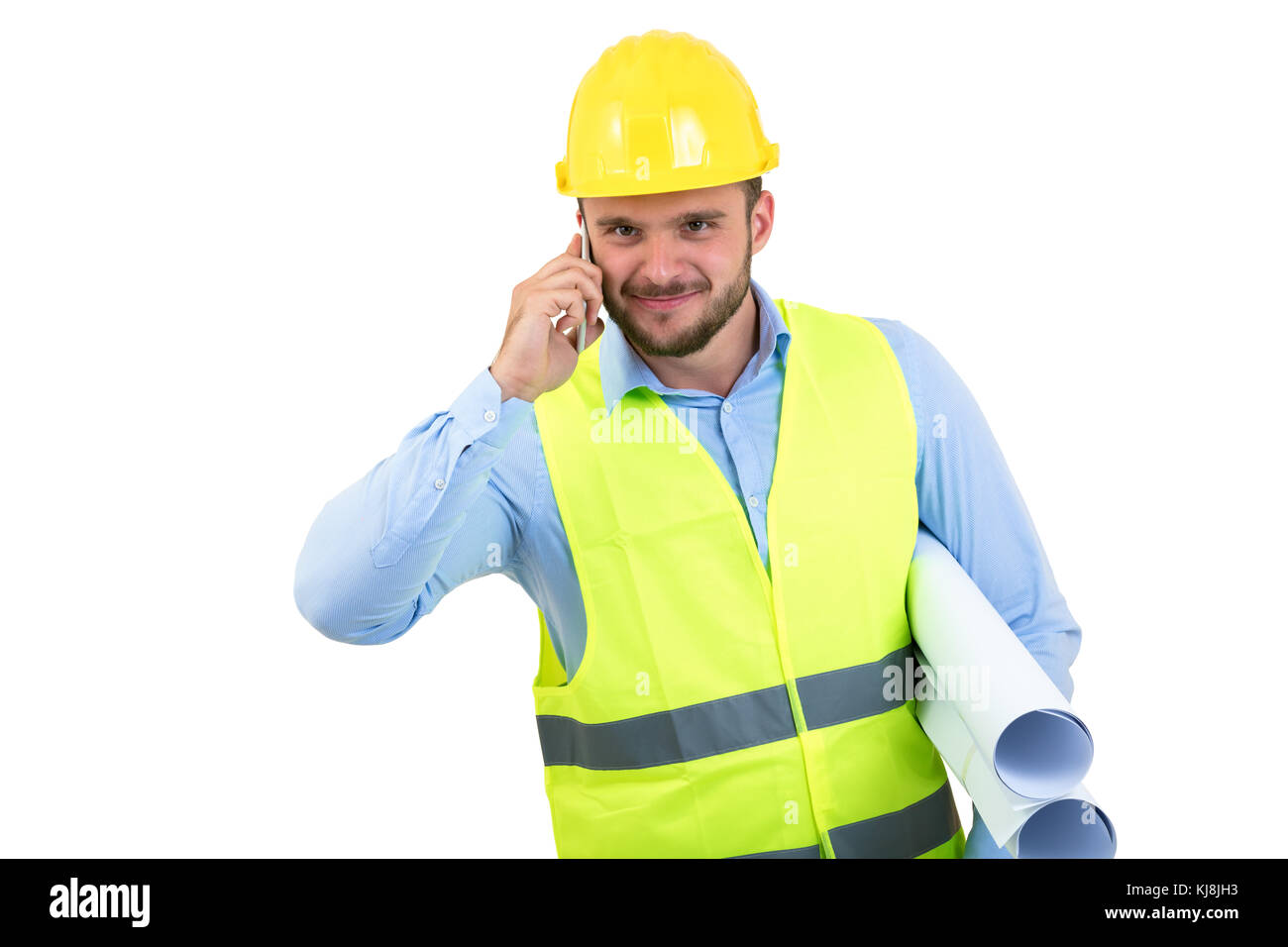 Angry upset young construction engineer yeling at the phone - Stock Image