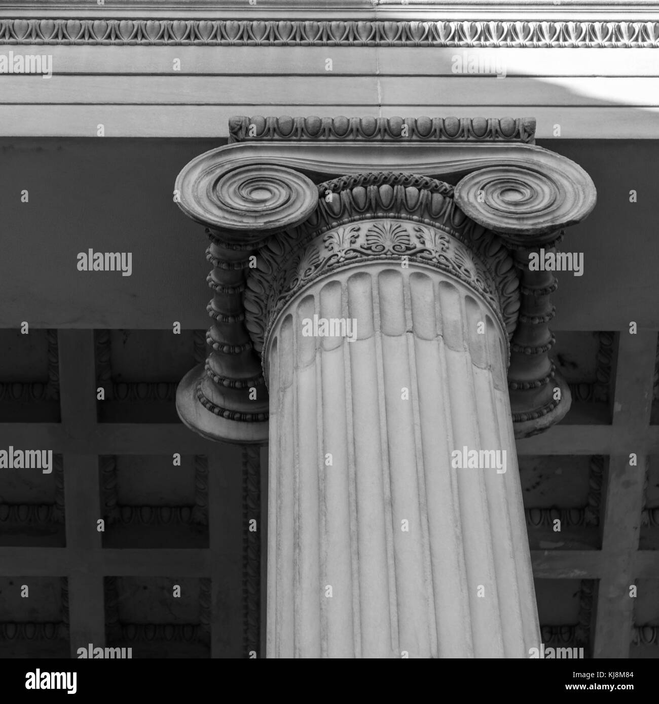 Close-up shot of a line of Greek-style columns - Stock Image