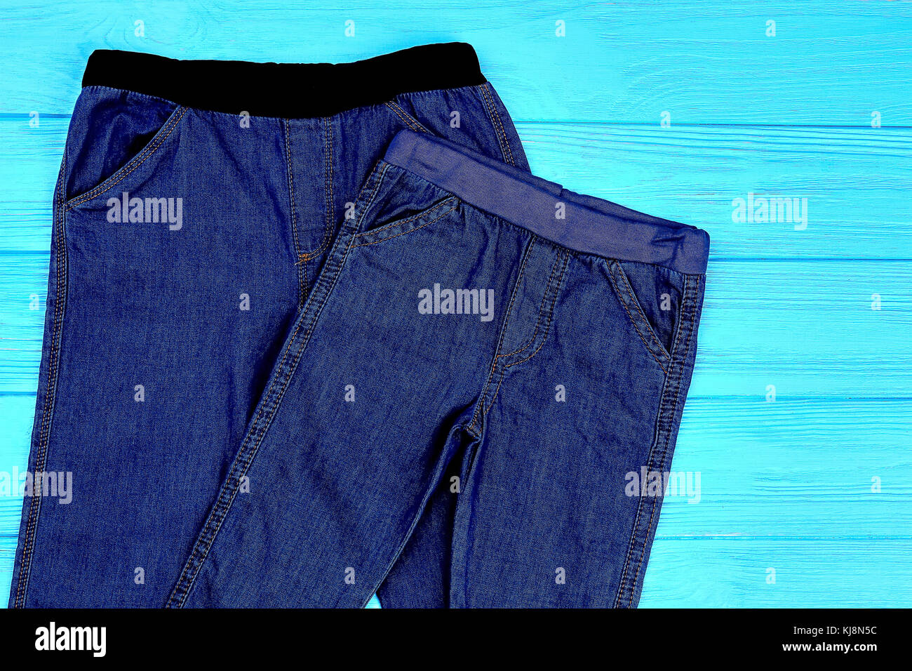 b8a572ce7b5 Close up of dark blue stretch jeans for child. Kids jean leggings for  casual wear. Children trendy denim clothes.
