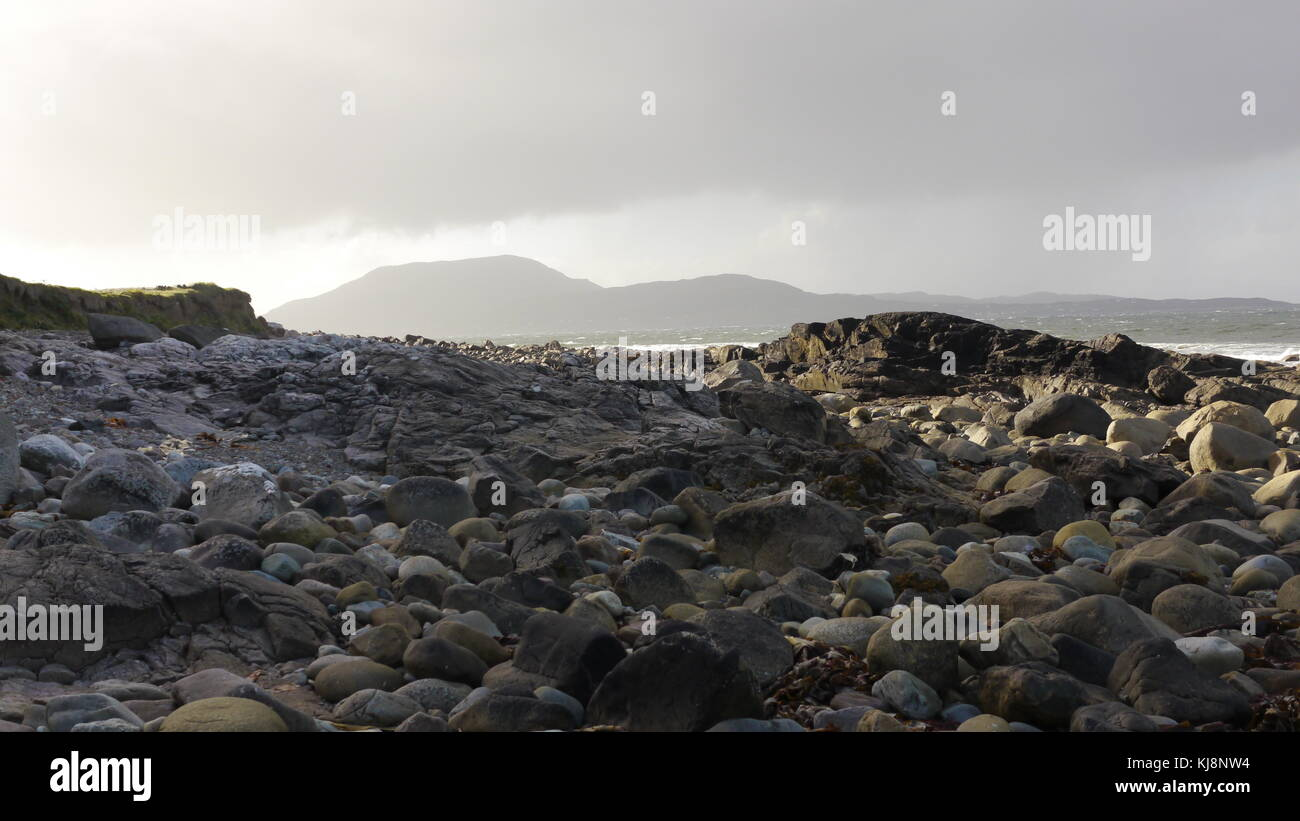The rugged landscape of the West of Ireland.The sun is trying it's hardest to breakthrough. - Stock Image