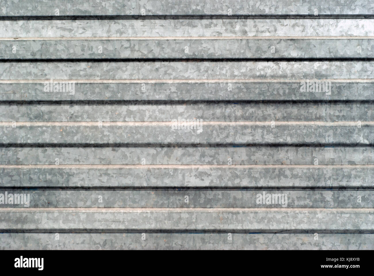background, texture: surface area of corrugated galvanized sheet metal - Stock Image