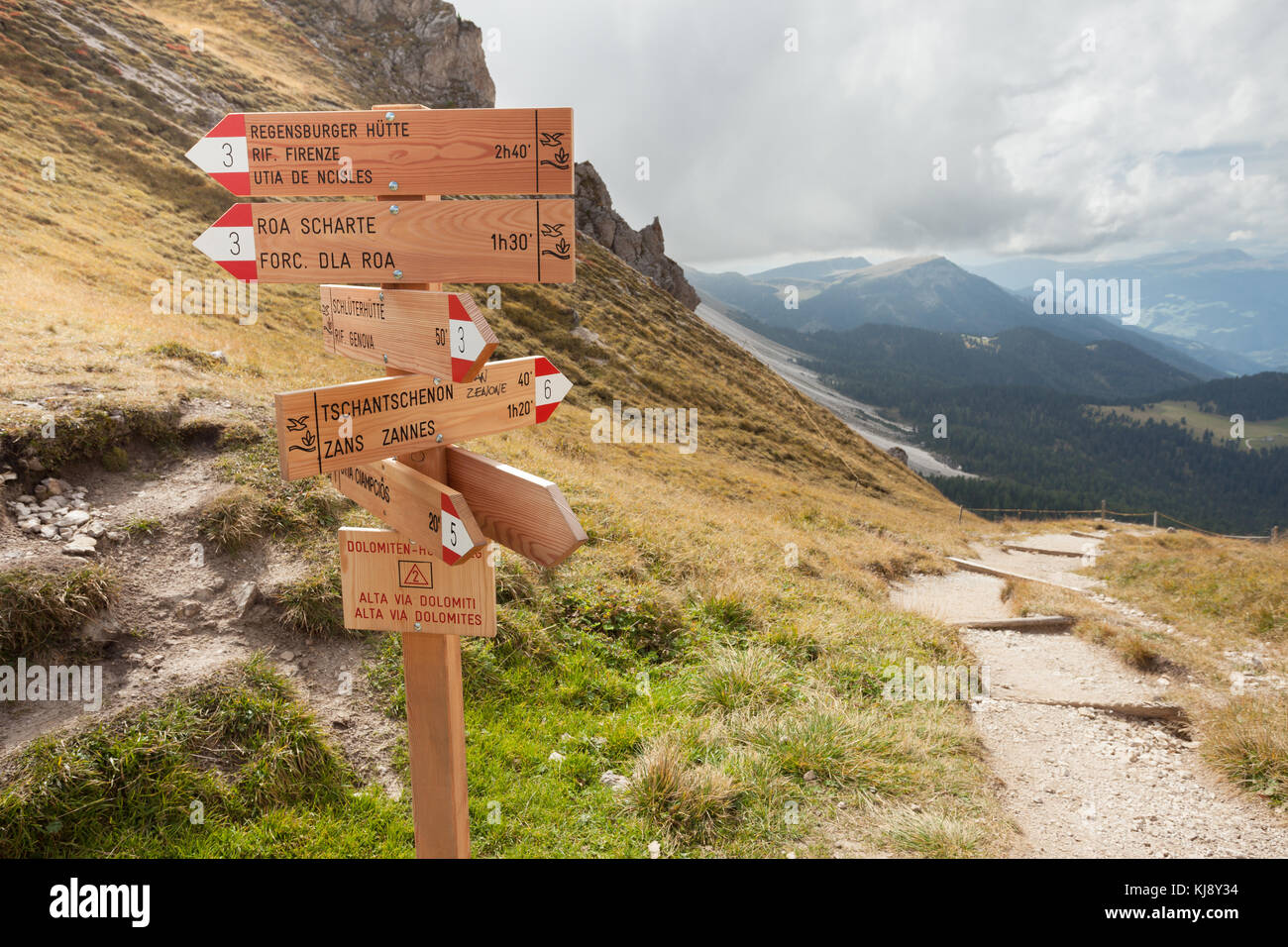 ST. MAGDALENA, ITALY - SEPTEMBER 15, 2015: In autumnal environment wooden path signs indicates the correct direction - Stock Image