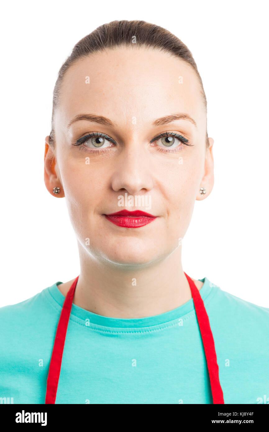 Portrait of female waiter or supermarket employee wearing red apron isolated on studio white background - Stock Image