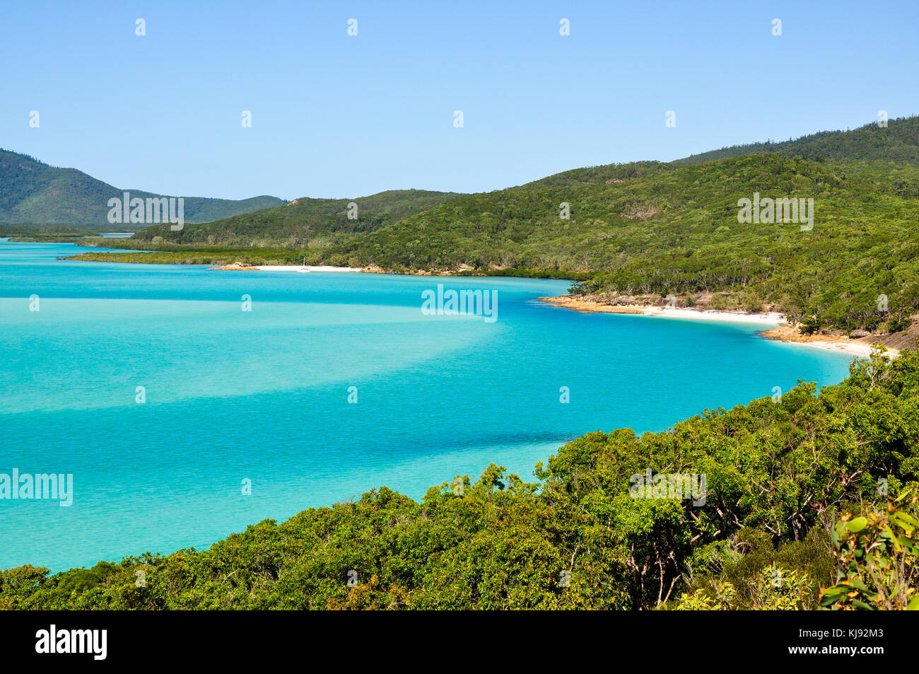 View down onto the tourquoise bay around Whitehaven beach on the Great Barrier Reef in Australia - Stock Image