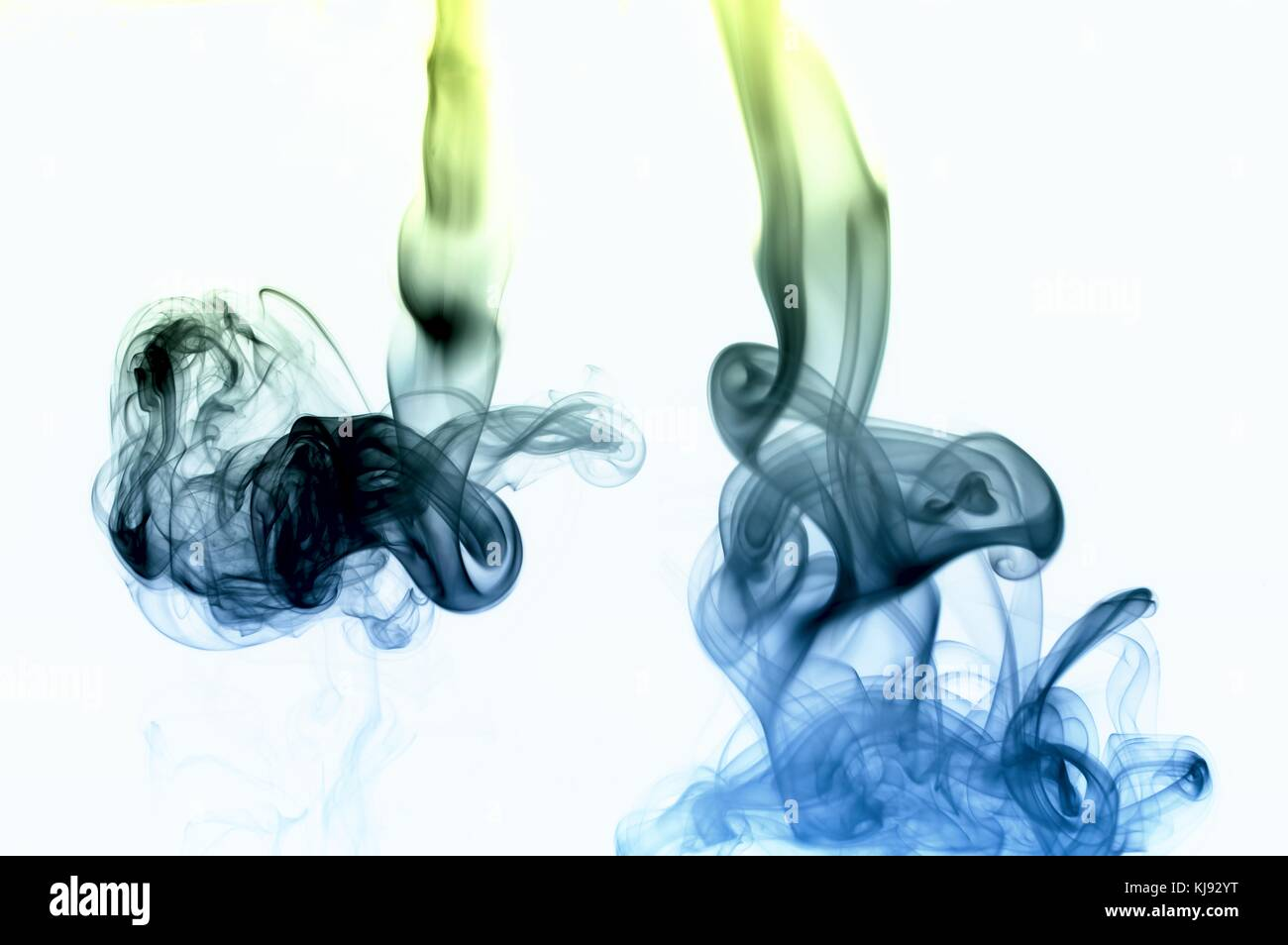 Abtract smoke shape in blue and green isolated on white - Stock Image
