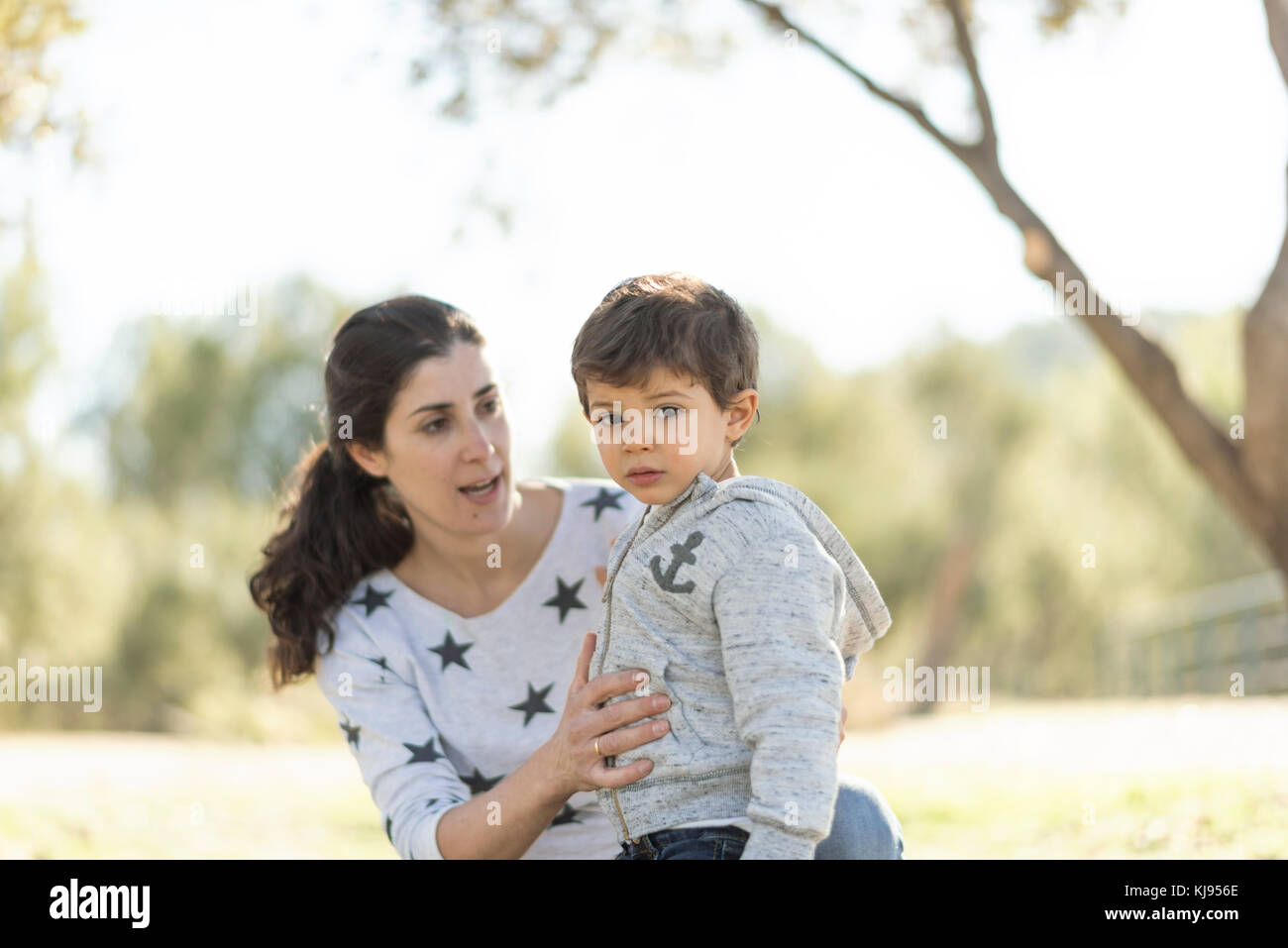 Mother and son in outdoors image in forest. - Stock Image