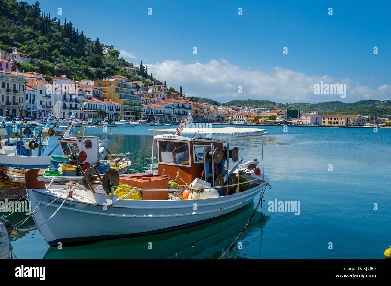 view of the traditional village of Githio with a fishing boat in foreground. Peloponnese Greece Stock Photo