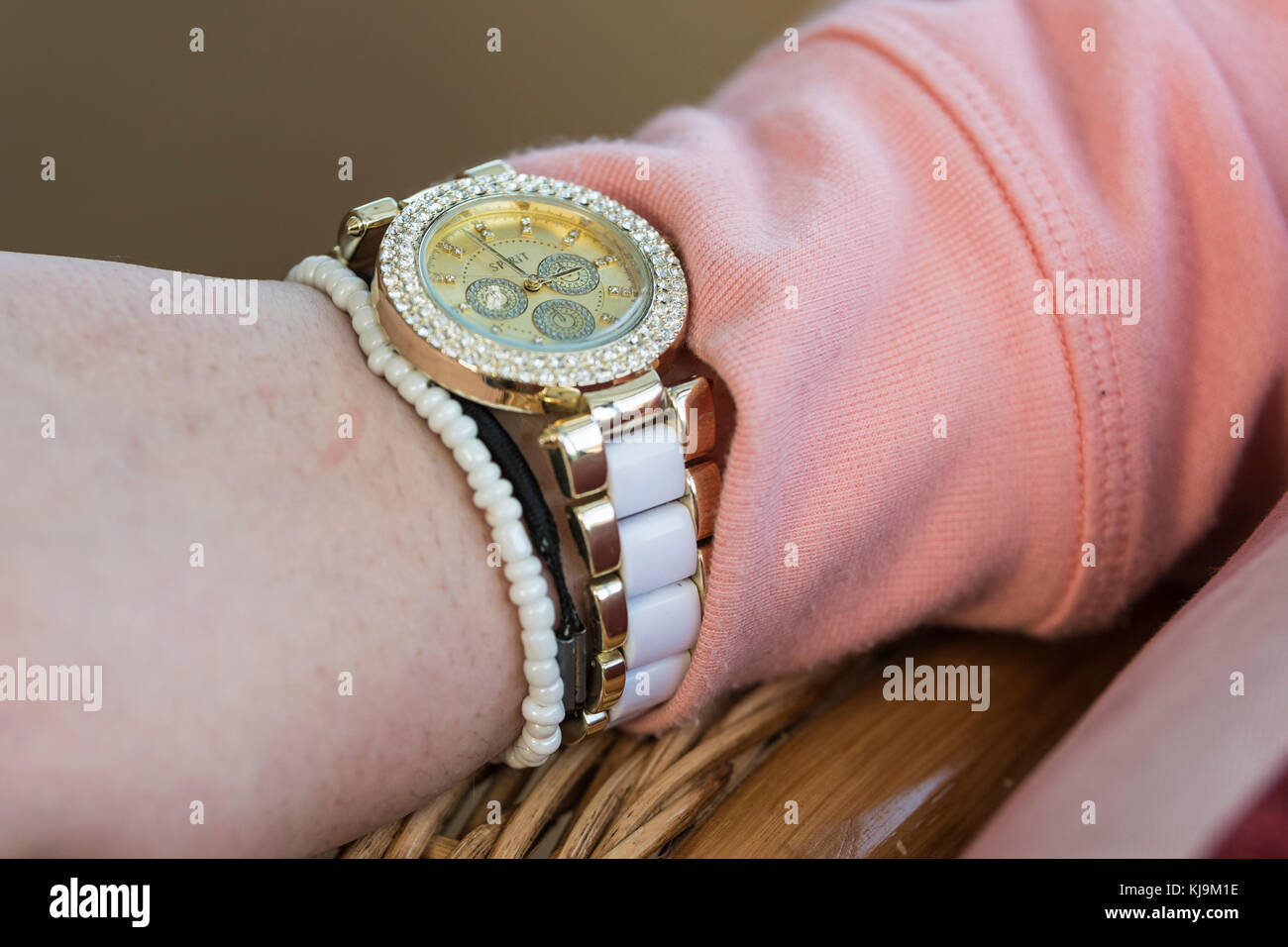 A woman's wrist wearing an expensive looking watch. - Stock Image