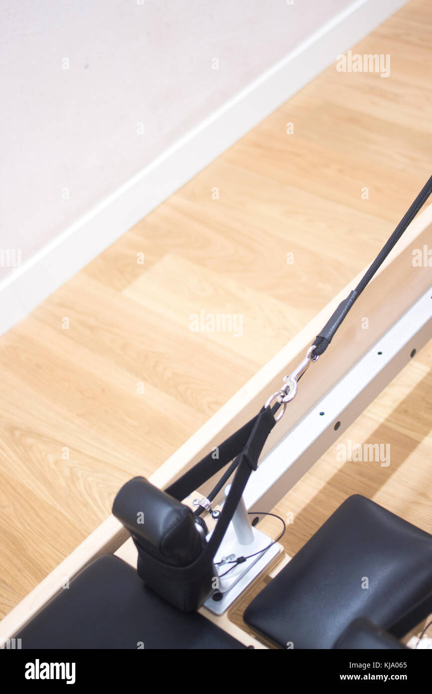 Reformer pilates studio machine for fitness workouts in gym. - Stock Image