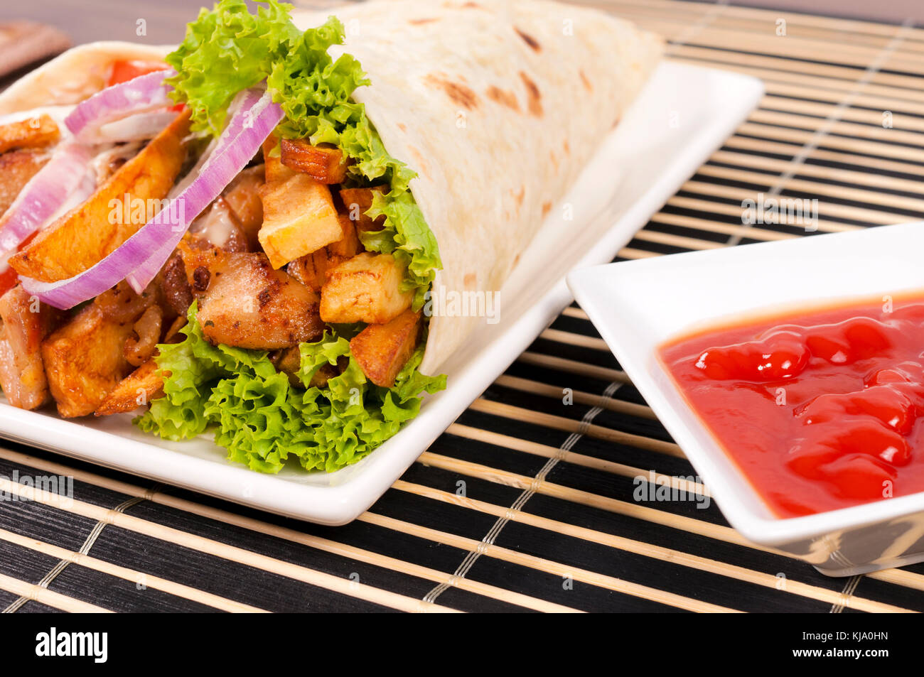 Tasty gyros portion with ketchup - Stock Image
