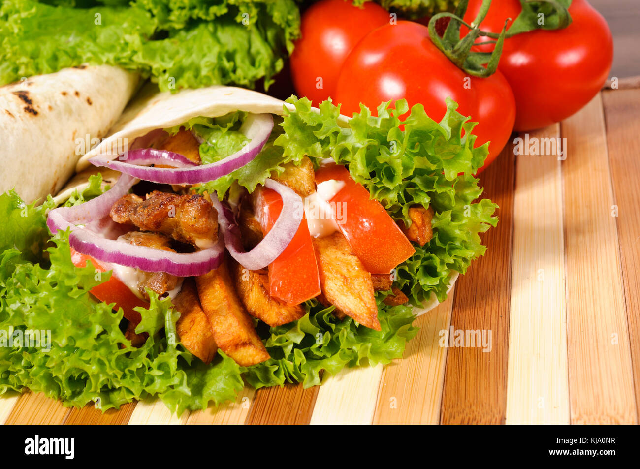 Tortillas with meat and vegetables - Stock Image