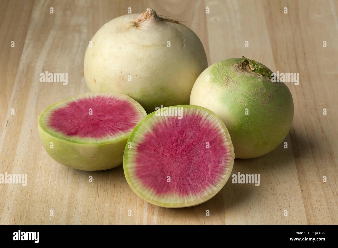 Whole and partial fresh raw watermelon radish - Stock Image