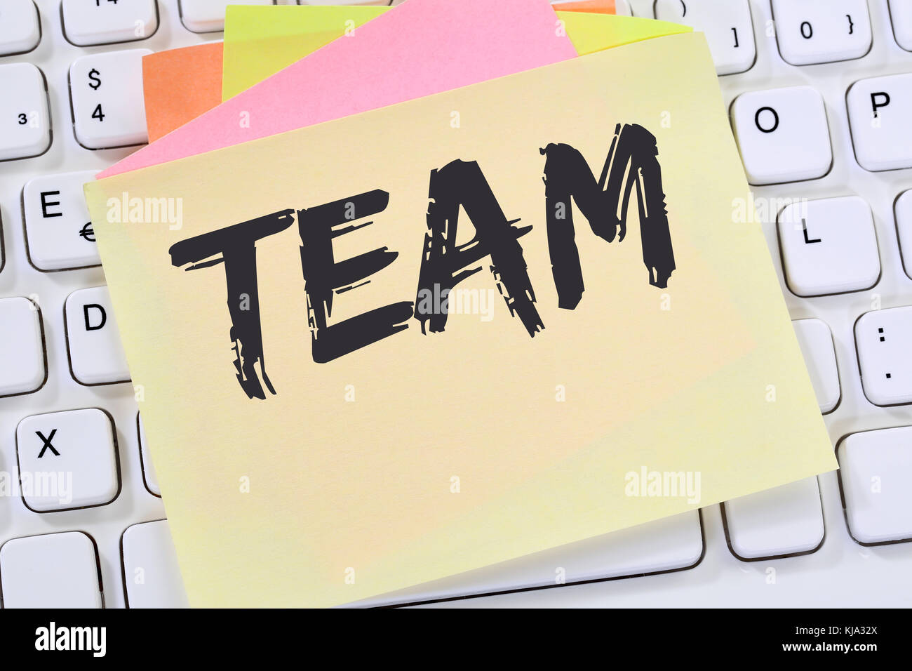 Team teamwork working together office business concept note paper computer keyboard - Stock Image