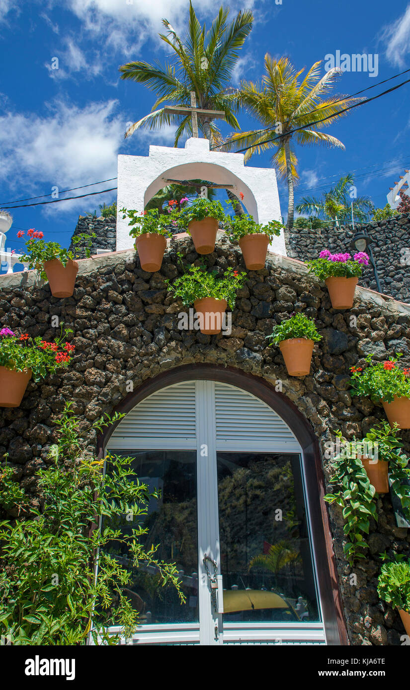 Tiny chapel made of lava stones at Puerto de Santiago, west site of the island,Tenerife island, Canary islands, - Stock Image