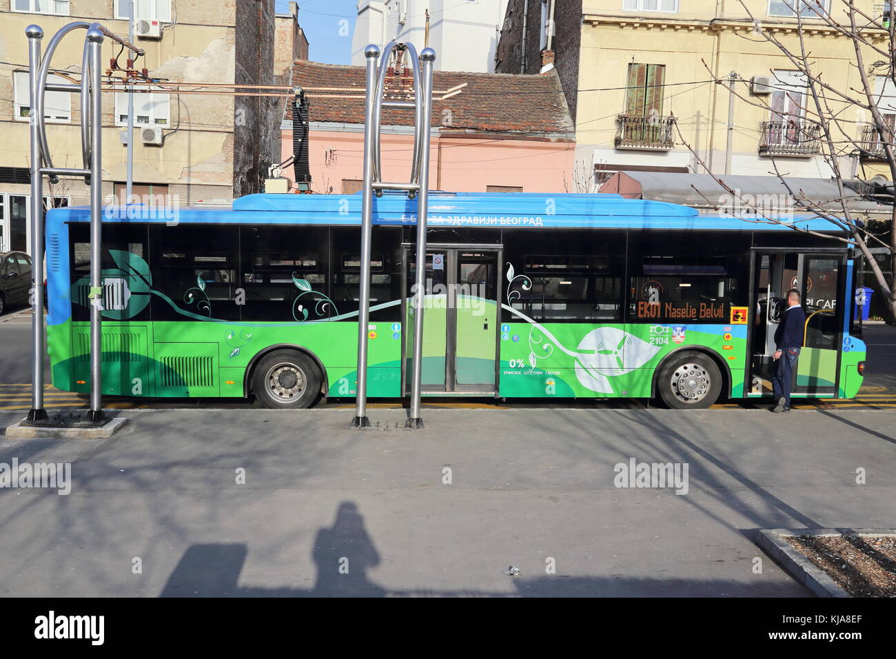 Chariot motors electric bus charging at the bus stop in the center of Belgrade, Serbia - Stock Image