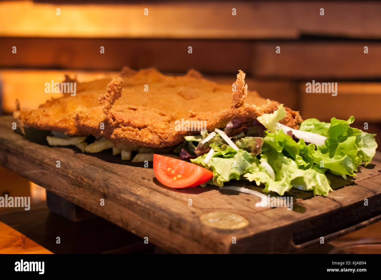 Cachopo, a typical Asturian dish that consists of two large breaded veal fillets filled with ham and cheese - Stock Image