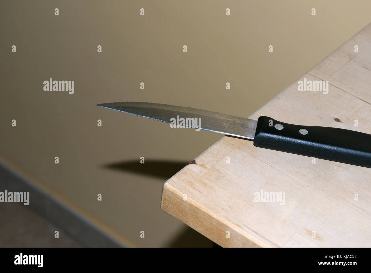 kitchen knife on table - Stock Image