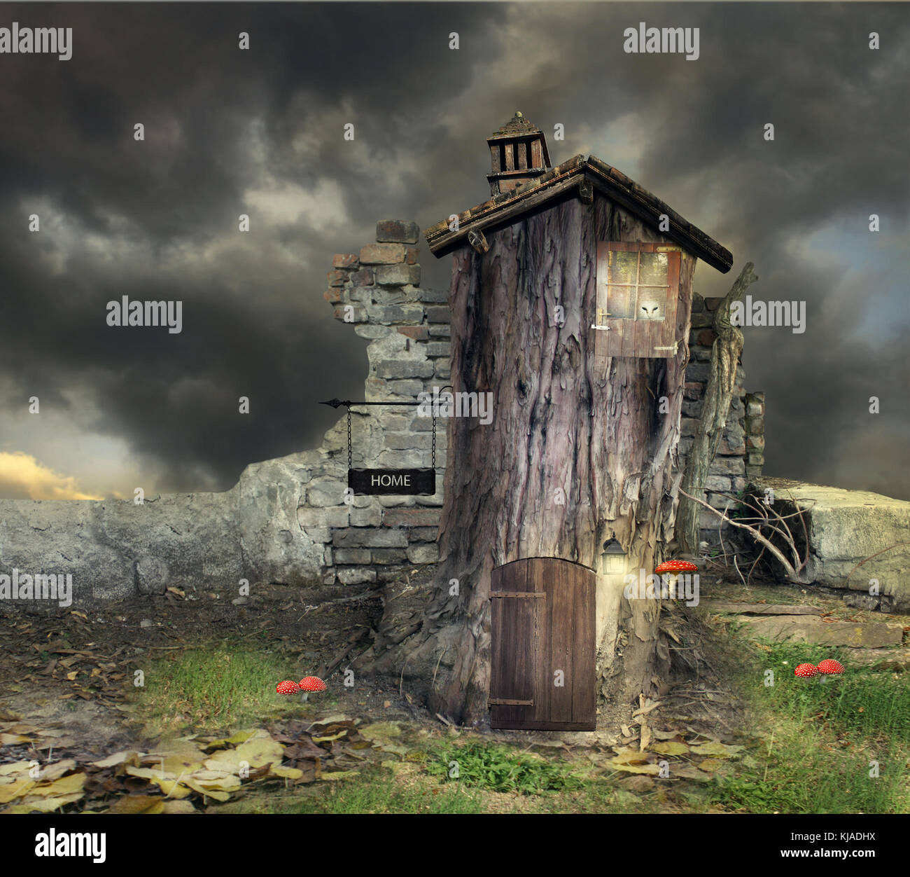 Fantasy landscape with a tree with door window and roof like a house with many details in a magical atmosphere - Stock Image
