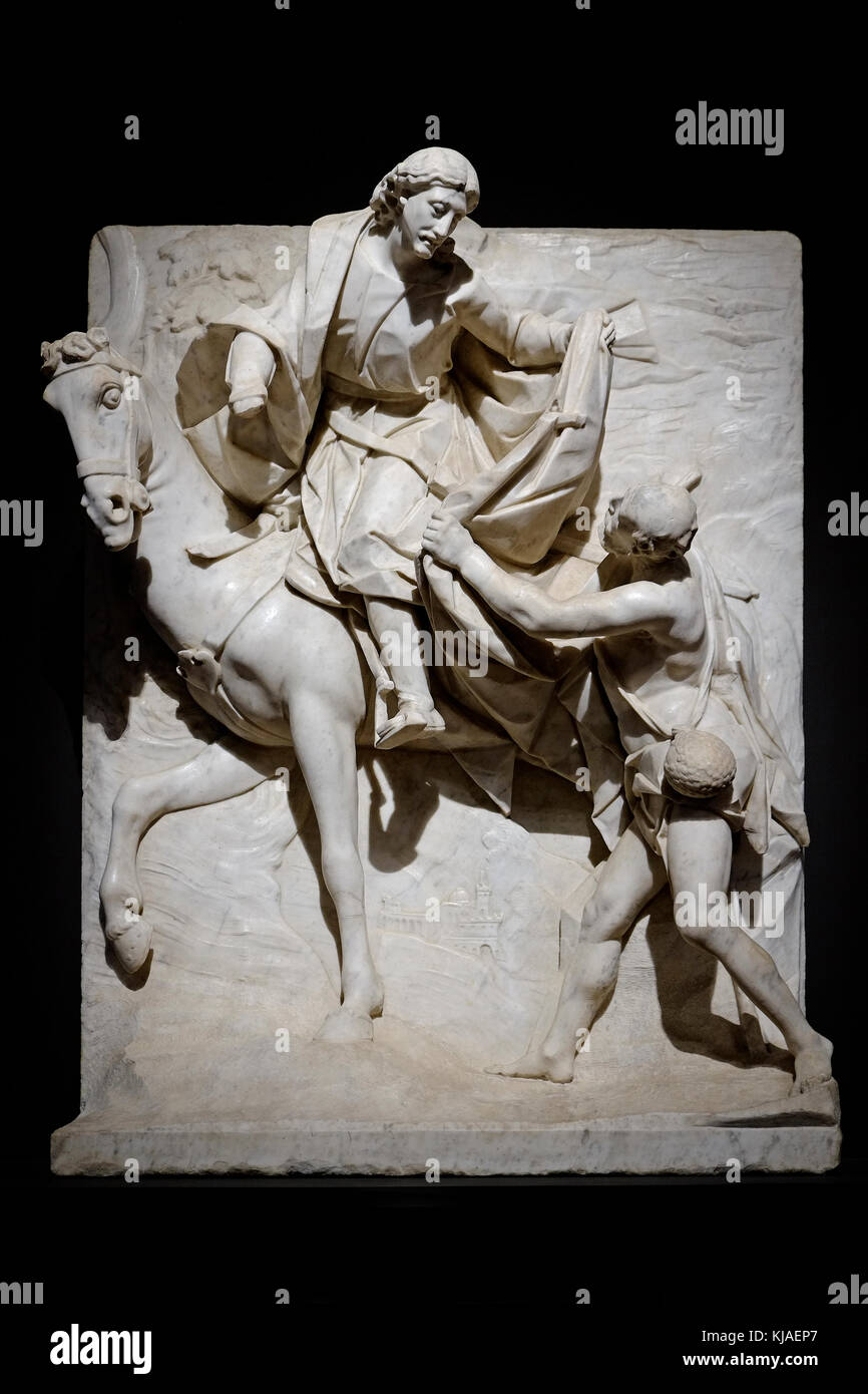 st martin sharing his cloak with beggar, palazzo strozzi, florence, italy - Stock Image