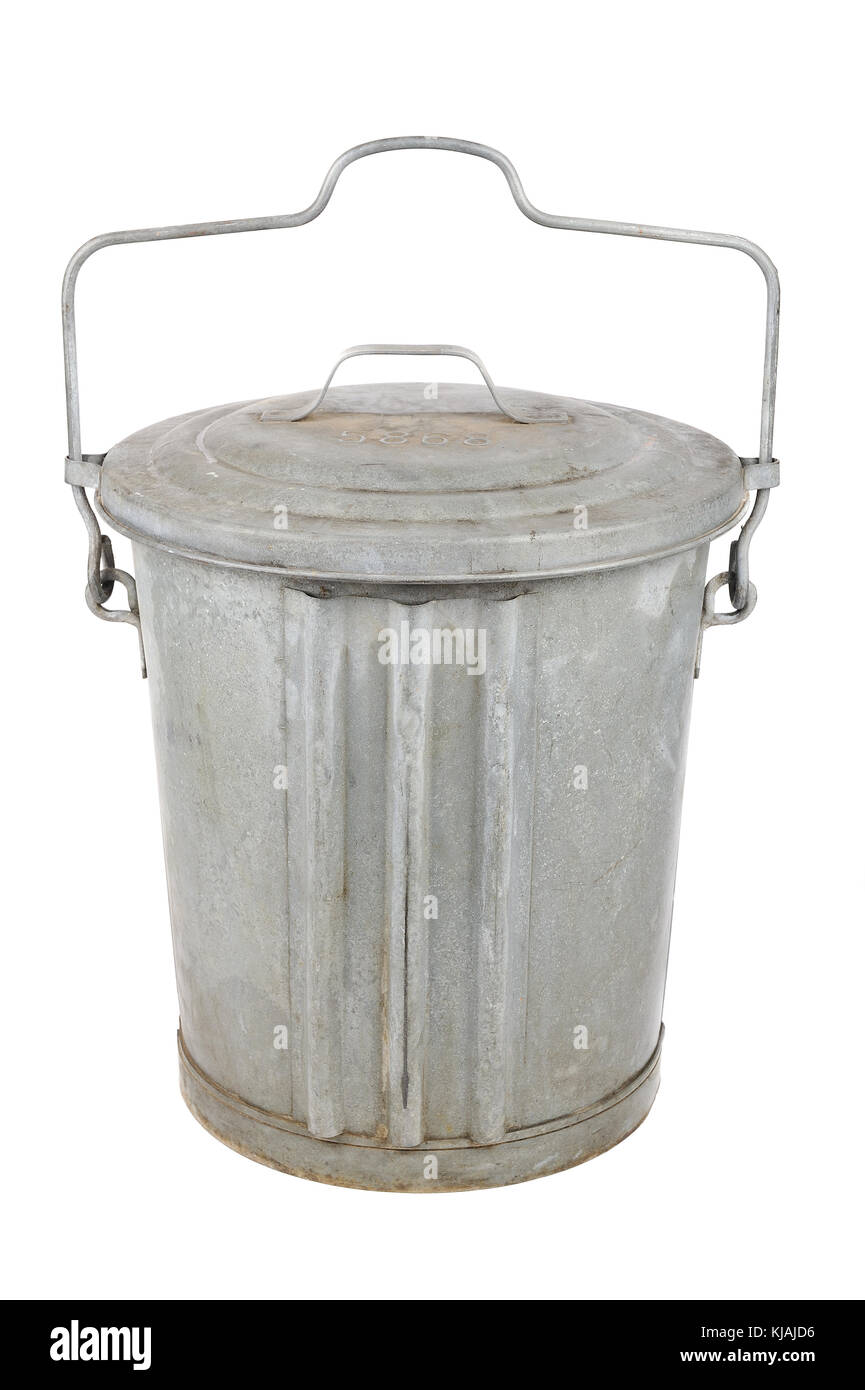 Old galvanized metal garbage can with lid and handle isolated on white - Stock Image
